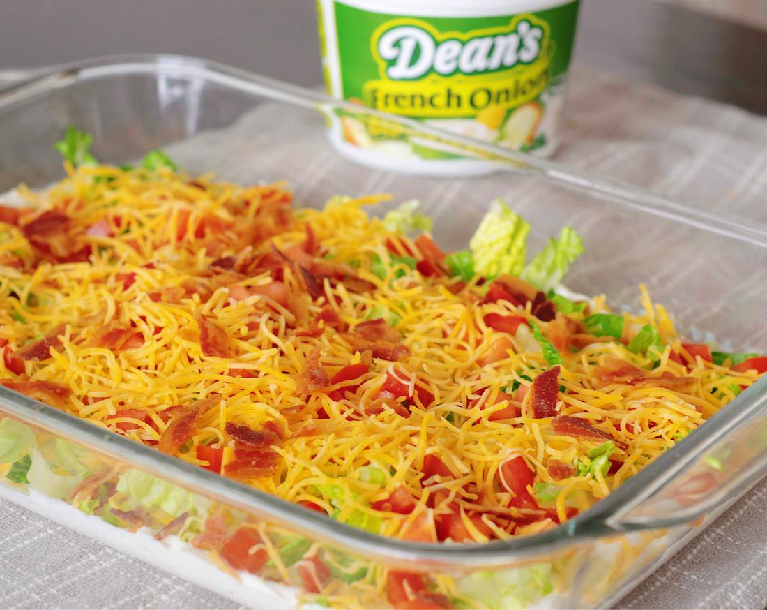 French Onion Layered BLT Dip Is made with Dean's French Onion Dip.